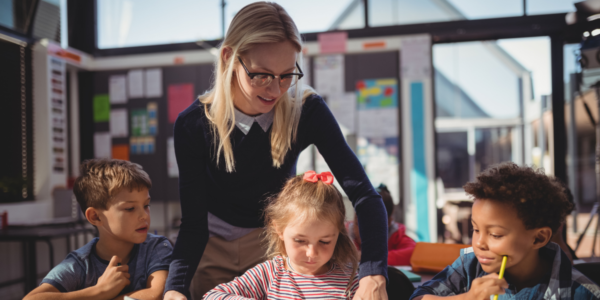 Cover image of teacher teaching children for a blog post